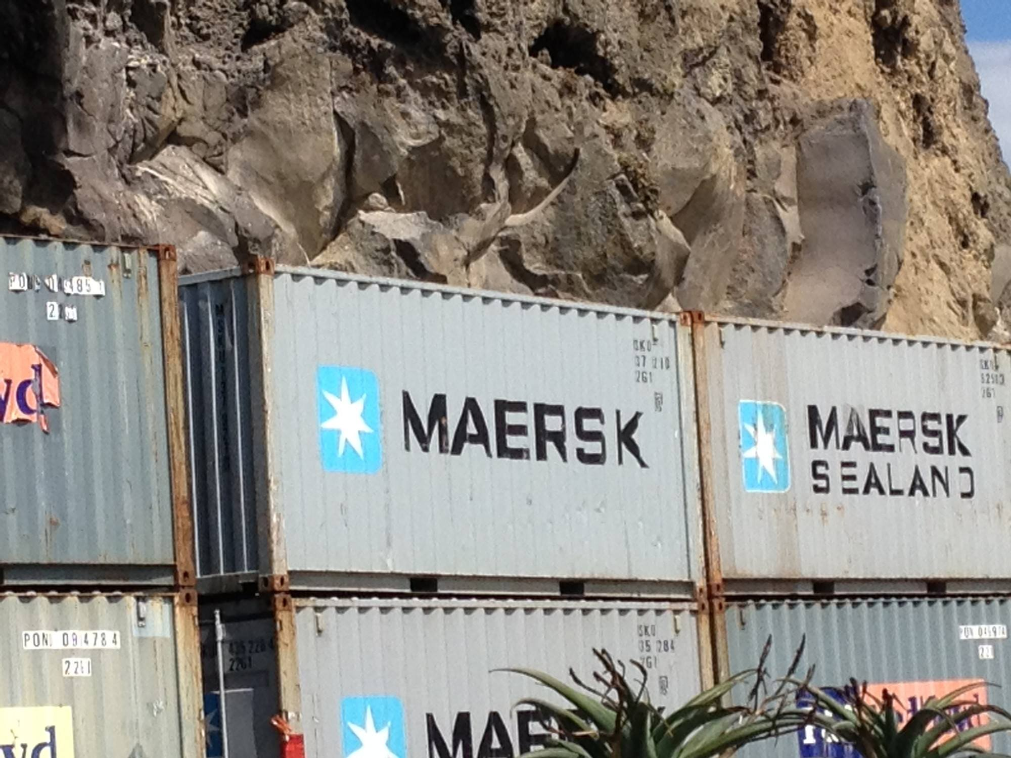 Shipping container retaining walls