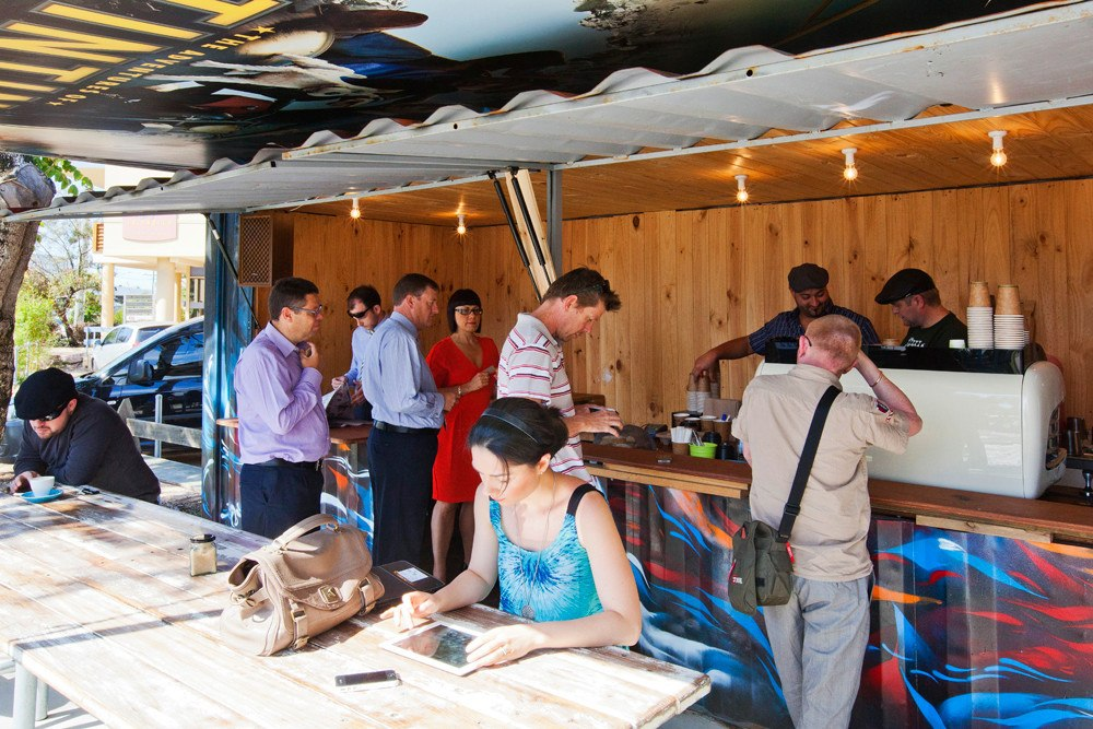 Customers at Mambo shipping Container Coffee Shop